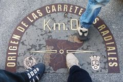 Foot on the zero kilometer Madrid, Spain royalty free stock images