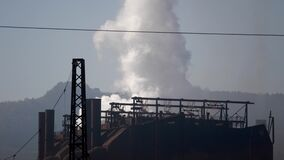 Footage of an atmospheric pollution from a factory, harmful gases go off into the air