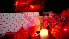 Footage of ballon, gift boxes, flower and candle burning. Valentine decoration
