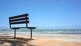 Bench near the beach. Footage of Bench near the beach. Beautiful and stunning blue skies with wind stock video