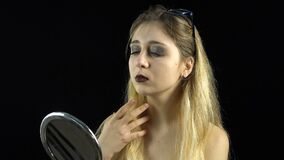 Looking in mirror blond woman stock video footage
