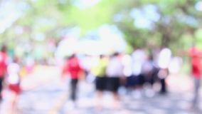 Footage blurred background of crowd of people walking on the street. Footage blurred background of crowd of people walking on the street in Songkran festival stock video