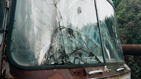A broken windshield on an old and abandoned truck. This is footage of A broken windshield on an old and abandoned truck stock video footage