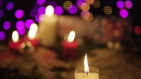 Footage of candle burning and gift with lamp shiny. Christmas day. Collection stock video footage