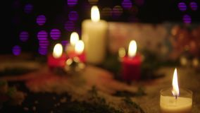 Footage of candle burning and gift with lamp shiny. Christmas day. Collection stock footage