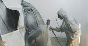 Car painting with professional spray gun stock video