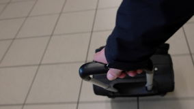 Suitcase in an airport. Footage of a carry on suitcase being pulled through an airport stock footage