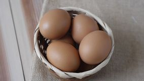 Pick up the eggs from the basket. Footage clip video Pick up the eggs from the basket with close up view