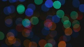 Video of colour lights with bokeh effect. Footage of colour lights with bokeh effect on black background stock video