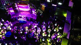 Footage of a crowd or group of young, stylish multi-ethnic people during colorful party in different clothes . Dancers stock video footage