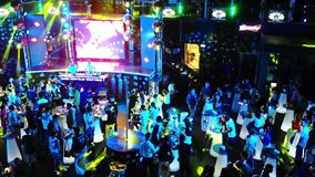Footage of a crowd or group of young, stylish multi-ethnic people during colorful party in different clothes . Dancers. Having fun dancing at a party . Shoting stock footage