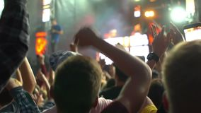 Crowd concert phone hand. Footage of a crowd partying at a rock concert hand phone stock video footage