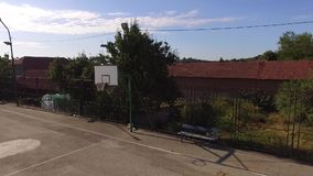 Empty summer basketball court and bench next to. This is a footage of Empty summer basketball court and bench next to stock video