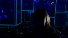 Footage of a female DJ scratching on the disk.  stock footage