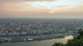 Mist over modern european city on sunrise. Time lapse. Footage of foggy morning in modern european city at riverside. Misty sunrise cityscape in Budapest stock video footage
