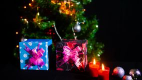 Footage of gift boxes, candle burning, tree and ornament Christmas stock video footage