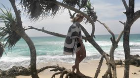 Happy Girl Ocean View Super Slowmotion. Footage of a girl with the ocean in front in Sri Lanka. Slowmotion shot stock footage