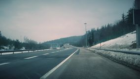 Highway traffic 4K Video. This is footage of Highway traffic in slovenia stock footage