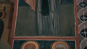 Holy icons drawn on a pillar in a monastery