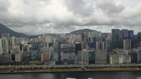 Footage of Hong Kong and Kowloon cityscape view from sky. Drone footage of Hong Kong and Kowloon city from the sky stock video
