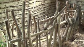 Interior of the abandoned hut. feeder for sheep. This is a footage of interior of the abandoned hut. feeder for sheep stock video footage
