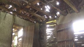 Interior of old and abandoned house, ceiling, door and window. This is footage of Interior of old and abandoned house, ceiling, door and window stock video
