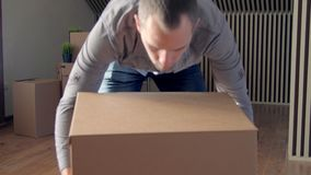 Footage of man moving big cardboard boxes stock footage