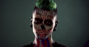 Footage of mans face with colored skeleton makeup. Face art, professional zombie face makeup stock video