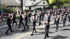Middle school band performs in parade. This is a footage of a middle school marching band performs in the parade stock video footage