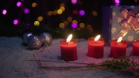 Footage moving of candle burning, balls, and gift with lamp shiny. Christmas. Collection stock video