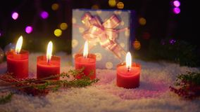 Footage moving of candle burning, balls, and gift with lamp shiny. Christmas. Collection stock footage