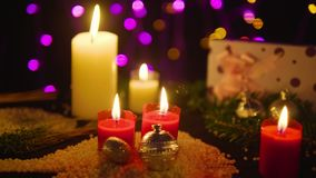 Footage moving of candle burning and gift with lamp shiny. Christmas. Collection stock video footage