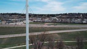 Footage Of Moving Towards A White Suspension Bridge. In Denver, Colorado stock footage