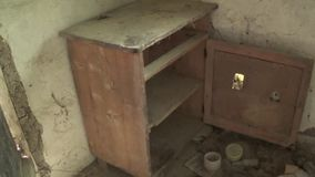 Old and abandoned chest in the interior of the house stock footage
