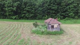 Old abandoned house in the middle of the meadow. This is a footage of Old abandoned house in the middle of the meadow stock video footage
