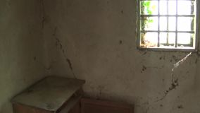 An old chest and a window in the interior of an old and abandoned house. This is footage of An old chest and a window in the interior of an old and abandoned stock footage