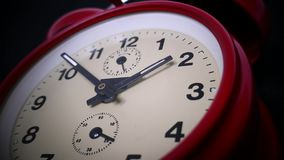 Footage of an old red clock isolated on a black background.  stock video footage