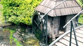 Old traditional water mill in southeast Europe. This is footage of Old traditional water mill in southeast Europe stock video footage