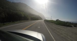 Footage from outside of a car on a road stock video