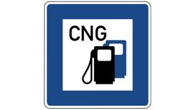 Footage of a petrol station with compressed natural gas traffic sign, the shot is coming into focus and goes out of focus again stock video