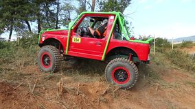 Footage of red off road car is terrain stock video footage
