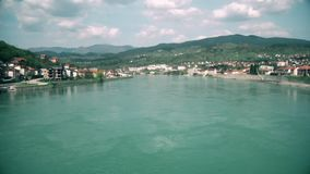 Slow flying over the lake, beautiful scenery. This is footage of Slow flying over the lake, beautiful scenery in south east europe stock footage