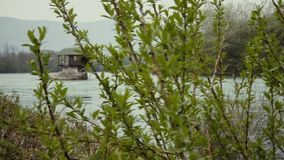 A small cabin on the river. This is footage of a small cabin on the river in city Baina Basta on Serbia in South east Europe stock footage