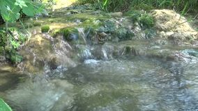 Small river running through the mountain. This is a footage of small river running through the mountain stock footage
