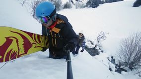 Footage of snowboarders man and girl adventure at mountain backcountry. stock footage