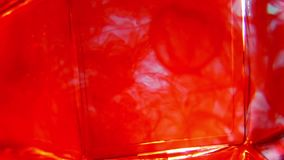 Splashing paint in water. A footage of splashing red paint in the water stock video footage