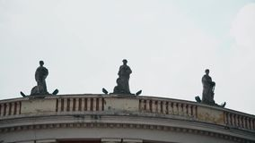 Statues on the top of the building. This is footage of statues on the top of the building in south east Europe stock footage