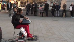 Handpan music player on Trafalgar Square in London stock footage