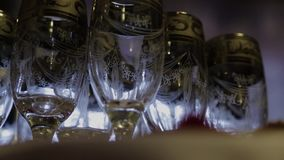 Footage of stylish wine glasses for wine tasting in fine dining winery with wine on table.  stock footage