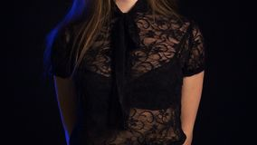 Footage of teenage girl in black lace blouse. On black background stock video footage
